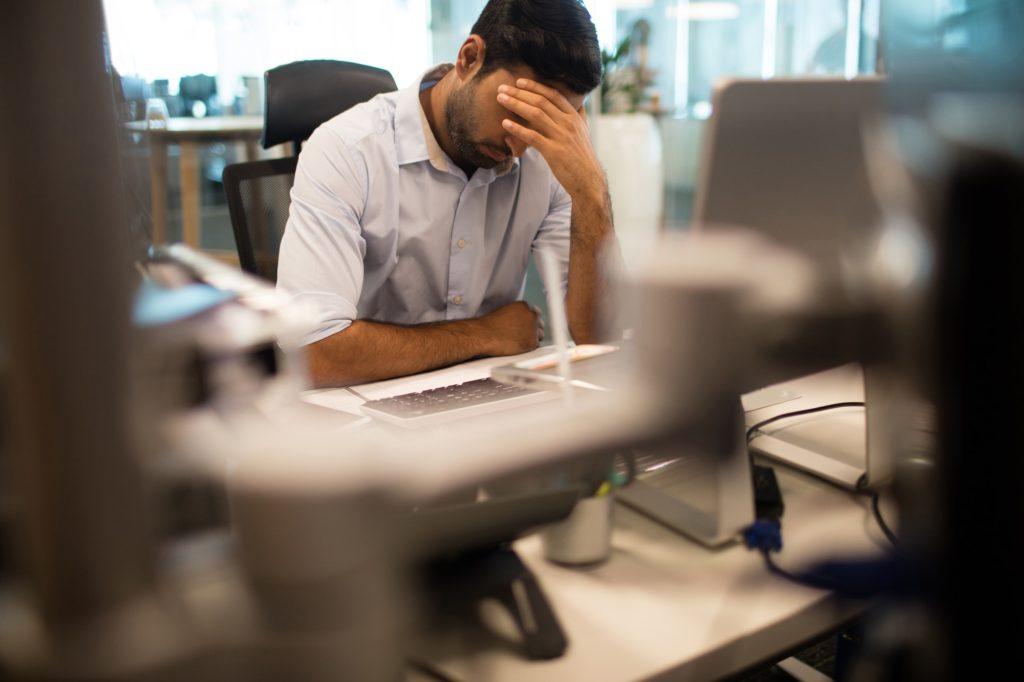 Worried businessman sitting in office